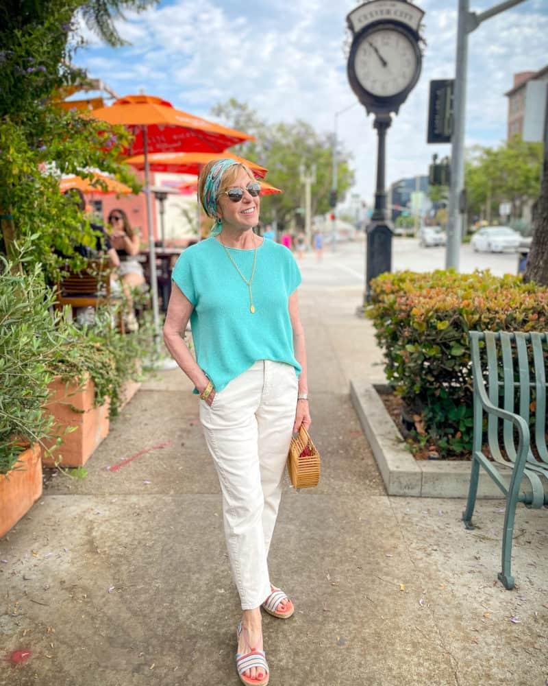 Susan B. wears a vintage Chanel scarf, Eileen Fisher linen top, undyed jeans, striped espadrille sandals.