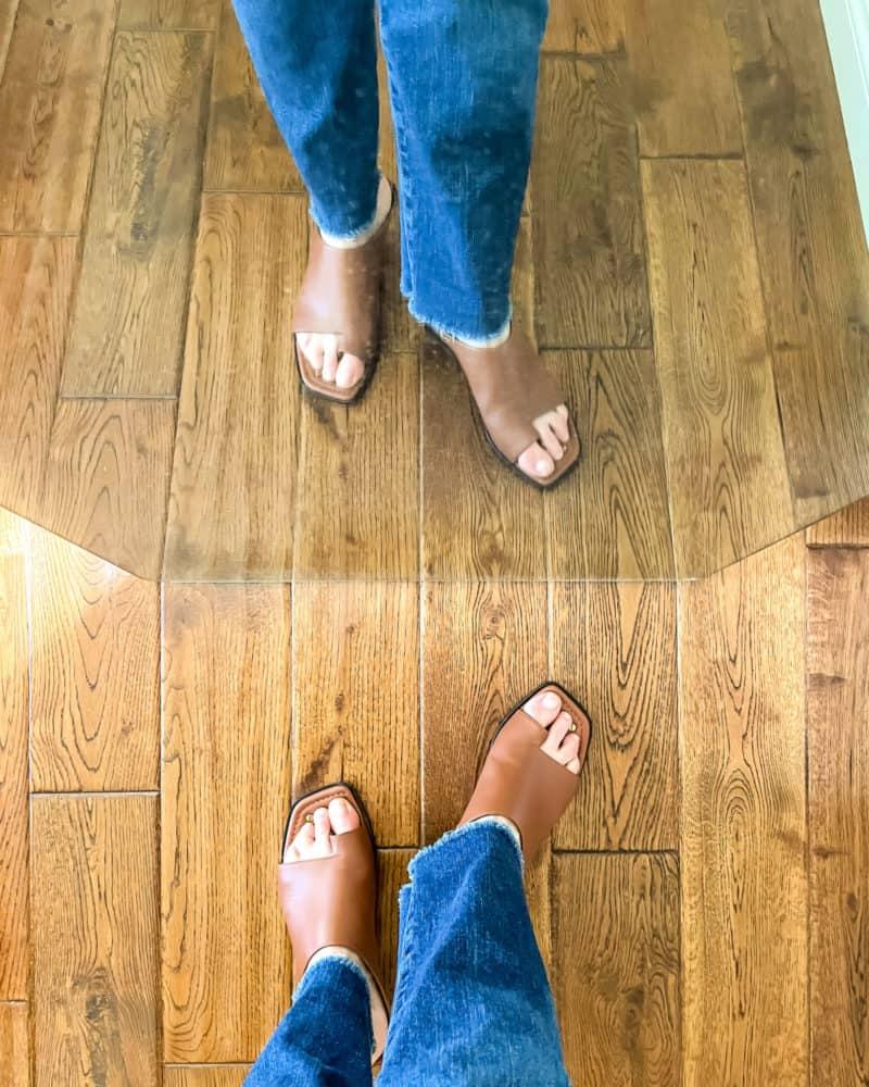 Susan B. wears raw hem jeans with Frame le Beachwood sandals.
